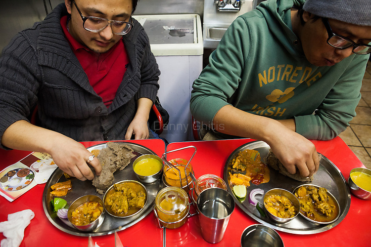 Ramesh lama, right, and Bividh Thapa eat dhendo thalis at Dhaulagiri Kitchen, a tiny Nepalese restaurant in Jackson Heights. <br /> <br /> Danny Ghitis for The New York Times