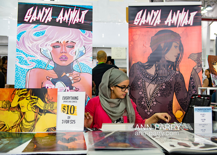 Manhattan, New York City, New York, USA. October 10, 2015. SANYA ANWAR, a Canadian comic artist and illustrator, is at Artist Alley at the 10th Annual New York Comic Con. Anwar, a Muslim, has her own comic book 1001 which retells the life of Scherezade from One Thousand and One Arabian Nights. NYCC 2015 is expected to be the biggest one ever, with over 160,000 attending during the 4 day ReedPOP event, from October 8 through Oct 11, at Javits Center in Manhattan
