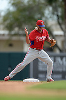Philadelphia Phillies infielder Kevin Frandsen (28) loses the ball on a double play attempt during a spring training game against the Baltimore Orioles on March 7, 2014 at Ed Smith Stadium in Sarasota, Florida.  Baltimore defeated Philadelphia 15-4.  (Mike Janes/Four Seam Images)