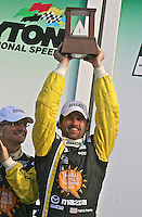 30 January 2011: Actor/driver Patrick Dempsey celebrates his first podium finish, Rolex 24 at Daytona, Daytona International Speedway, Daytona Beach, FL (Photo by Brian Cleary/www.bcpix.com)