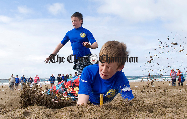 Barry Clancy and Hugh Mc Mahon in action for Clare during the National Lifesaving Championships in Spanish Point. Photograph by Declan Monaghan