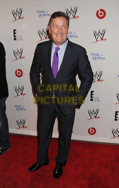 Piers Morgan<br /> WWE &amp; E! Entertainment's &quot;SuperStars For Hope&quot; supporting Make-A-Wish at The Beverly Hills Hotel in Beverly Hills, CA., USA.<br /> August 15th, 2013<br /> full length grey gray black suit purple tie blue shirt hands in pockets <br /> CAP/ROT/TM<br /> &copy;Tony Michaels/Roth Stock/Capital Pictures
