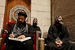 Israel, Jerusalem Old City, Coptic clergy at the Church of the Holy Sepulchre. Easter 2005<br />