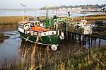 Houseboats on River Deben tidal estuary at Felixstowe Ferry, Suffolk, England, UK