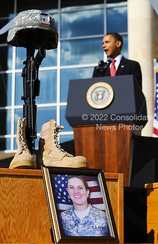Fort Hood, TX - November 10, 2009 -- U.S. President Barack Obama speaks from behind a photo of slain Sergeant Amy S. Krueger during the memorial service for the 12 soldiers and one civilian killed at Fort Hood U.S Army Post near Killeen, Texas, USA 10 November 2009. Army Major Malik Nadal Hasan reportedly shot and killed 13 people, 12 soldiers and one civilian, and wounded 30 others in a rampage 05 November at the base's Soldier Readiness Center where deploying and returning soldiers undergo medical screenings..Credit: Tannen Maury / Pool via CNP