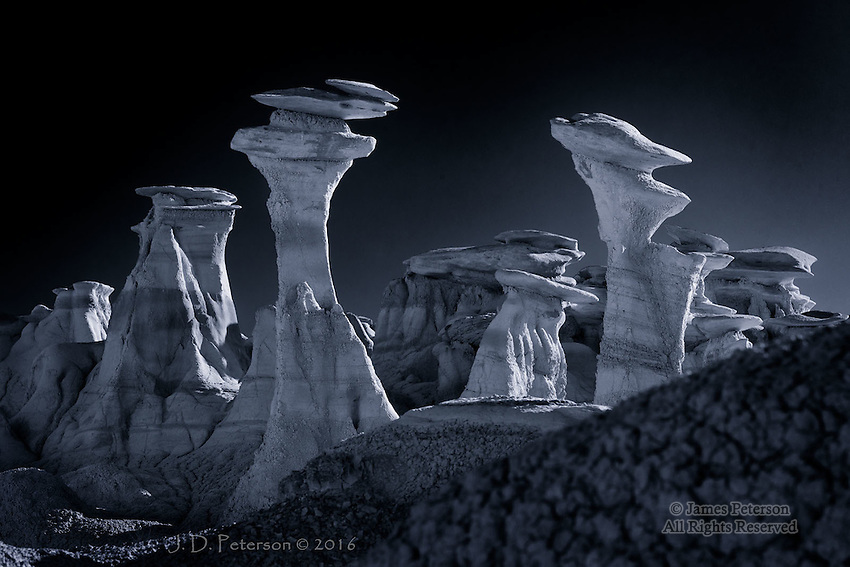 Nest of Hoodoos, Bisti Badlands, New Mexico  &copy;2016 James D Peterson.  Mother Earth creates a haunting embodiment of her inner moods in this eerie landscape.<br />