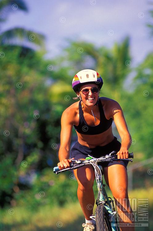 A woman enjoys a bike ride on Maui's South Side.