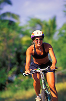 A woman enjoys a bike ride on Maui's South Side.