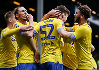 Leeds United's goalscorer Aapo Halme is congratulated by team mates Jack Clarke, Luke Ayling and Tyler Roberts <br /> <br /> Photographer Andrew Kearns/CameraSport<br /> <br /> The Emirates FA Cup Third Round - Queens Park Rangers v Leeds United - Sunday 6th January 2019 - Loftus Road - London<br />  <br /> World Copyright &copy; 2019 CameraSport. All rights reserved. 43 Linden Ave. Countesthorpe. Leicester. England. LE8 5PG - Tel: +44 (0) 116 277 4147 - admin@camerasport.com - www.camerasport.com