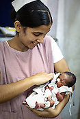 Sister Suman Kumari holds a 2 month premature baby in the new born baby in the nursery of Duncan Hospital in Raxaul of East Champaran district of Bihar, India. Since 2008 the Foundation and Geneva Global have been investing in the training of medical staff to improve the lives of people living in 600+ villages in the region. The NGOs are delivering cost effective interventions to address treatment, care and prevention of diseases, disability and preventable deaths amongst infants, adolescent girls and women of child-bearing age. There is statistical and anecdotal evidence that there have been vast improvements and a total of 40-50% increased immunization for all children under 6 has meant that communities can be serviced and educated long term. Photograph: Sanjit Das/Panos for Legatum Foundation
