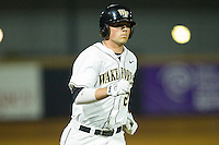 Charlie Morgan #26 of the Wake Forest Demon Deacons rounds the bases after hitting a 3-run home run against the Charlotte 49ers at Gene Hooks Field on March 22, 2011 in Winston-Salem, North Carolina.   Photo by Brian Westerholt / Four Seam Images