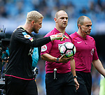 Kasper Schmeichel of Leicester City has words with referee Robert Madly as they go off at half time during the English Premier League match at the Etihad Stadium, Manchester. Picture date: May 13th 2017. Pic credit should read: Simon Bellis/Sportimage