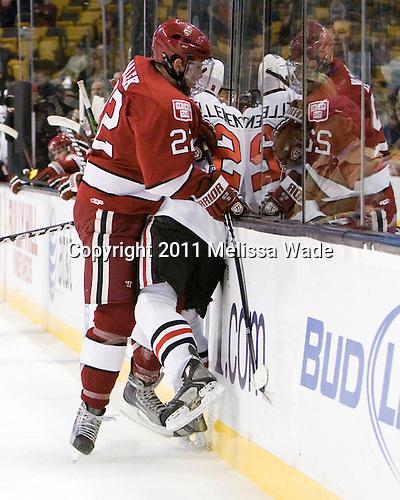 David Valek (Harvard - 22), Drew Ellement (Northeastern - 2) - The Northeastern University Huskies defeated the Harvard University Crimson 4-0 in their Beanpot opener on Monday, February 7, 2011, at TD Garden in Boston, Massachusetts.