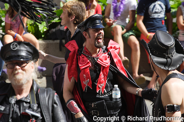 Men dressed in black leather participate in Montreal's Pride parde