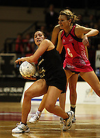 World 7 captain Natasha Chokljat tries to intercept a pass to Liana Barrett-Chase during the International  Netball Series match between the NZ Silver Ferns and World 7 at TSB Bank Arena, Wellington, New Zealand on Monday, 24 August 2009. Photo: Dave Lintott / lintottphoto.co.nz