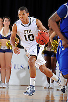 12 January 2012:  FIU guard Cameron Bell (10) handles the ball in the second half as the Middle Tennessee State University Blue Raiders defeated the FIU Golden Panthers, 70-59, at the U.S. Century Bank Arena in Miami, Florida.