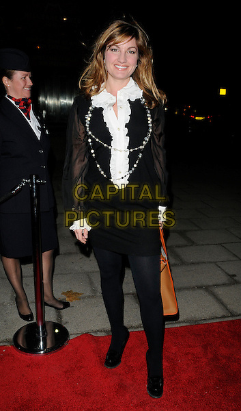 KARREN BRADY .At the Evening Standard Influentials Party, Altitude 360, Millbank Tower, London, England, UK, .16th November 2010..full length white ruffle shirt blouse pearl necklace black dress tights cuffs brown tan bag .CAP/CAN.©Can Nguyen/Capital Pictures.