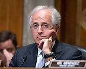 """United States Senator Bob Corker (Republican of Tennessee) listens as US Secretary of State Mike Pompeo testifies before the US Senate Committee on Foreign Relations on """"An update on American Diplomacy to Advance our National Security Strategy"""" on Capitol Hill in Washington, DC on Wednesday, July 25, 2018.  Pompeo took questions on the Helsinki Summit with President Putin of Russia and progress on the denuclearization of North Korea.<br /> Credit: Ron Sachs / CNP"""