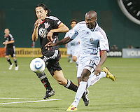 Juan Manuel Pena #3 of D.C. United runs up beside Omar Cummings #14 of the Colorado Rapids during an MLS match on May 15 2010, at RFK Stadium in Washington D.C. Colorado won 1-0.