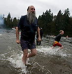 Jon Forseth, one of the original foundering members of the Olalla polar bears, walks out of the Burley Lagoon during the 24th annual Polar Bear jump in Olalla, Washington on January 1, 2008. This was his 24th trip into the icy waters, while his grandson, Gunther Lewis R) completed his first jump. Jim Bryant Photo. ©2010. ALL RIGHTS RESERVED.