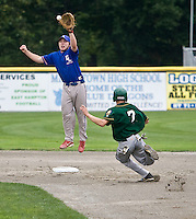 MIDDLETOWN, CT - 05 AUGUST 2010 -.East Longmeadow Post 293's Sean Harrington jumps to catch a ball as Warwick, RI's New England Frozen Lemonade's Manuel Carvalho slides safely into second during Thursday's American Legion Northeast Regional Tournament game at Palmer Field in Middletown..Photo by Josalee Thrift