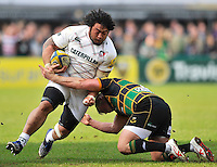 Northampton, England. Logovi'i Mulipola of Leicester Tigers tackled by Dylan Hartley (Captain) of Northampton Saints during the Northampton Saints and Leicester Tigers  during the Aviva Premiership match at Franklin's Gardens, Northampton, England on March 29, 2014