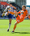 KILMARNOCK'S TIM CLANCY AND DUNDEE UTD'S STUART ARMSTRONG CHALLENGE FOR THE BALL