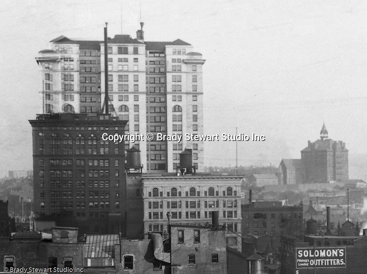 Pittsburgh PA:  View of the Frick building and Duquesne College  from the roof of the Empire Building.  Building was completed in 1902 and is still in operation today. The building overshadows the smaller Carnegie Building (in front of Frick Building).