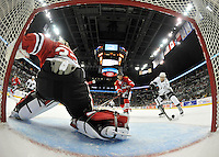 San Antonio Rampage's Quinton Howden, right, takes a shot on Rockford IceHogs goaltender Kent Simpson ahead of Rockford defenseman Adam Clendening, center, during the second period of an AHL hockey game, Saturday, Oct. 5, 2013, in San Antonio. (Darren Abate/M3D14.com)