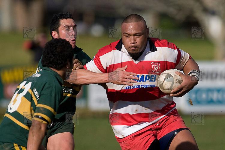 T. Paleilei takes on the Pukekohe midfield pair of J. Smith & I. Tuifua. Counties Manukau Premier McNamara Cup rugby game between Pukekohe & Karaka played at Colin Lawrie Fields Pukekohe on July 14th, 2007. Pukekohe won 31 - 29.