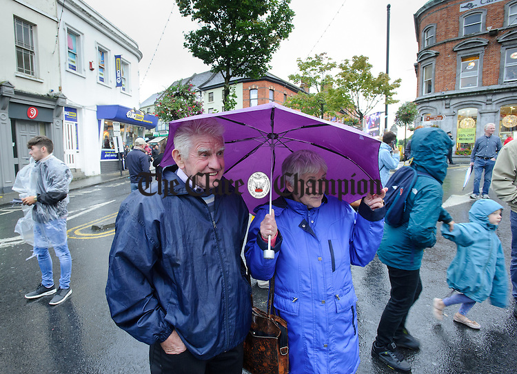 Frank and Nancy Mc Donagh of Liscannor enjoying the music of Fleadh Cheoil na hEireann in Ennis, despite the weather. Photograph by John Kelly.