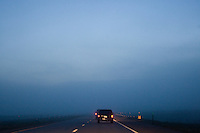 leaving0627 Luis Sanches and Daniel Diaz drive through fog in Nebraska while driving to Pennsylvania to start a new life. The two cars were filled with six illegal immigrants and four U.S. born children fleeing Arizona's new tough immigration law. (Pat Shannahan/ The Arizona Republic)