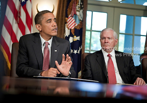 United States Secretary of Defense Robert M. Gates listens as U.S. President Barack Obama speaks to the press after a meeting in the Cabinet Room of the White House June 22, 2010 in Washington DC.  President Obama spoke about the war on terrorism, the Gulf of Mexico Oil spill and Gen. Stanley A. McChrystal's comments about the administration in a Rolling Stone..Credit: Brendan Smialowski - Pool via CNP