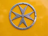 Chrome Maltese Cross on Maltese Bus - Detail