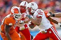 January 1, 2009:      Nebraska running back Roy Helu Jr. (10) during the  64th annual Konica Minolta Gator Bowl between the Nebraska Cornhuskers  and the Clemson Tigers  at Jacksonville Municipal Stadium in Jacksonville, Florida. Nebraska defeated Clemson 26-21.