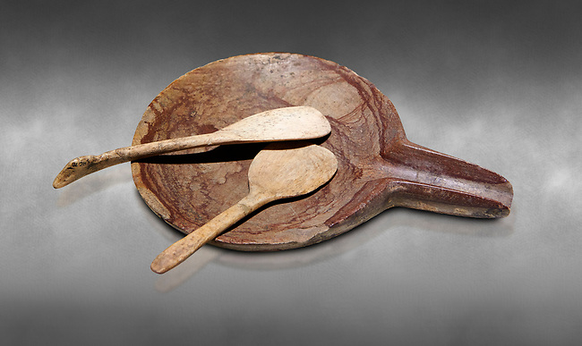 Neolithic stone plate with long spout and bone spoons. 6000 BC. Catalhoyuk Collections. Museum of Anatolian Civilisations, Ankara