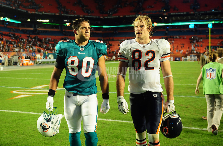 Nov. 18, 2010;  Miami, FL, USA; Chicago Bears tight end (82) Greg Olsen and Miami Dolphins tight end (80) Anthony Fasano following the game at Sun Life Stadium. The Bears defeated the Dolphins 16-0. Mandatory Credit: Mark J. Rebilas-