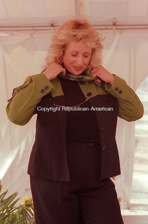 SOUTHBURY, CT 08/15/98 --0815jh07.tif--Model Diane Turchiano of New Milford wears a pant suit from Dress Barn during a fashion show held under a tent in the parking lot at Southbury Plaza in Southbury Saturday. JOHN HARVEY staff photo for Forsman story.