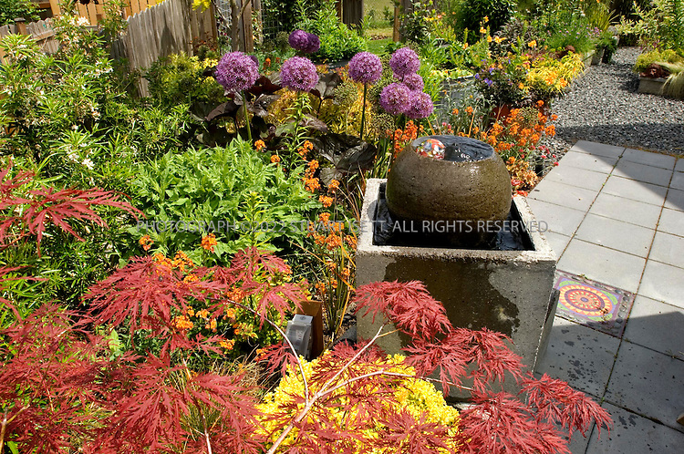 6/12/2007--Langley, WA, USA..Valerie Easton garden in Langley, on Whidbey Island, Washington. (email: valeaston@comcast.net). Here: fountain..Photograph ©2007 Stuart Isett.All rights reserved