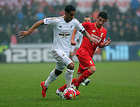 (L-R) Kyle Naughton of Swansea City marked by Cameron Brannagan of Liverpool  during the Barclays Premier League match between Swansea City and Liverpool at the Liberty Stadium, Swansea on Sunday May 1st 2016