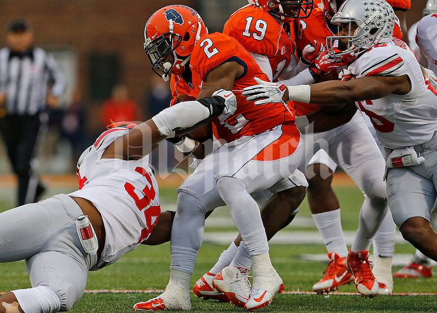 Illinois Fighting Illini quarterback Nathan Scheelhaase (2) is almost tackled by Ohio State Buckeyes defensive end Jamal Marcus (34) in the third quarter of their game at Memorial Stadium in Champaign, Ill on November 16, 2013. (Columbus Dispatch photo by Brooke LaValley)