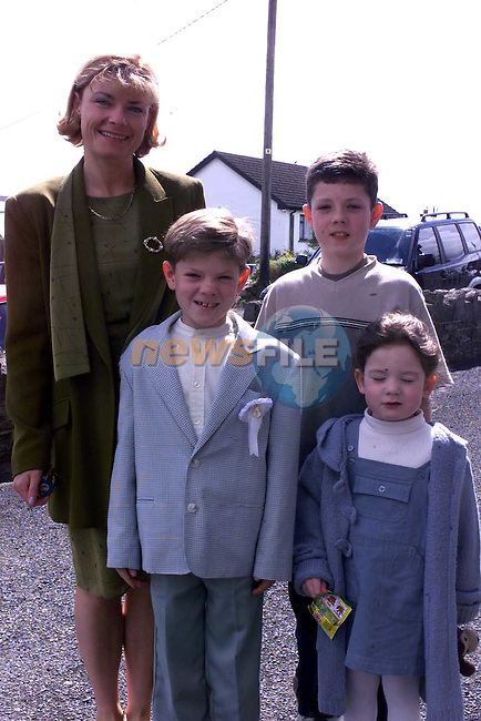 Ronan Carr with his sister Molly brother Mikie and mother Eileen at First communion in Tullyallen Church.Picture Fran Caffrey Newsfile