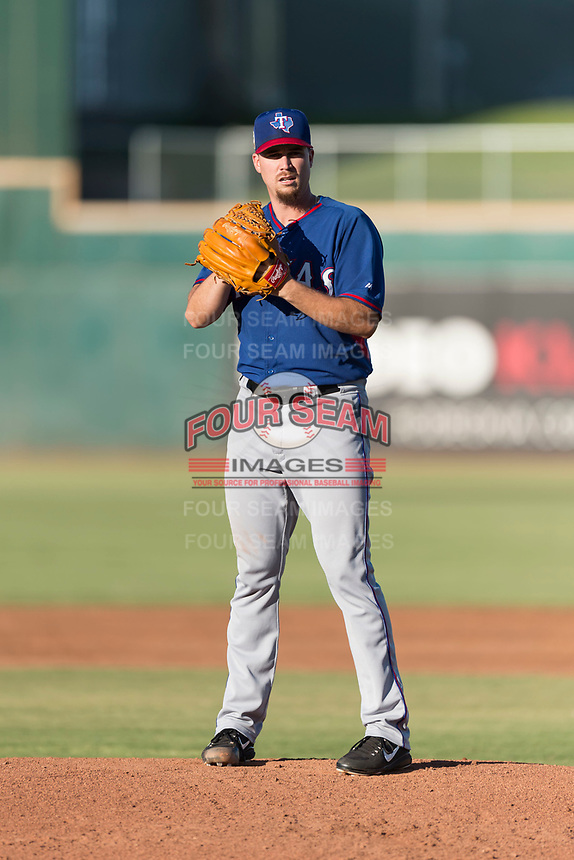 AZL Rangers starting pitcher Chi Chi Gonzalez (21) gets ready to deliver a pitch during a rehab start in an Arizona League playoff game against the AZL Indians 1 at Goodyear Ballpark on August 28, 2018 in Goodyear, Arizona. The AZL Rangers defeated the AZL Indians 1 7-4. (Zachary Lucy/Four Seam Images)