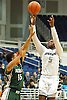 Jalen Burgess #5 of Elmont, right, shoots a jumper over Omar Baxter #15 of Valley Stream North during the Nassau County varsity boys basketball Class A semifinals at Hofstra University on Wednesday, Feb. 24, 2016. Elmont won by a score of 77-54.