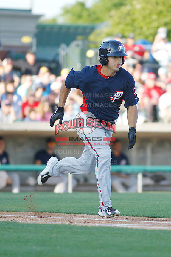 Potomac Nationals shortstop Stephen Perez (4) running to first base during a game against the Myrtle Beach Pelicans at Ticketreturn.com Field at Pelicans Ballpark on May 24, 2015 in Myrtle Beach, South Carolina.  Potomac defeated Myrtle Beach 1-0. (Robert Gurganus/Four Seam Images)
