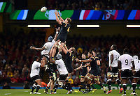 Bradley Davies of Wales rises high to win lineout ball. Rugby World Cup Pool A match between Wales and Fiji on October 1, 2015 at the Millennium Stadium in Cardiff, Wales. Photo by: Patrick Khachfe / Onside Images