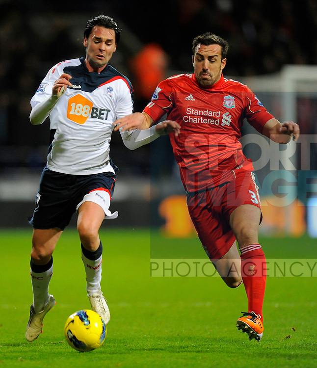 Chris Eagles of Bolton Wanderers and Jose Enrique of Liverpool.Barclays Premier League.Bolton Wanderers v Liverpool at the Reebok Stadium, Bolton. 21st January, 2012..Sportimage +44 7980659747.picturedesk@sportimage.co.uk.http://www.sportimage.co.uk/.Editorial use only. Maximum 45 images during a match. No video emulation or promotion as 'live'. No use in games, competitions, merchandise, betting or single club/player services. No use with unofficial audio, video, data, fixtures or club/league logos.