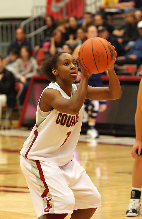 April Cook (#1), Washington State freshman guard, concentrates while shooting a free throw during the Cougars game against Montana State in Pullman, Washington, on November 23, 2008.  The Cougars prevailed in the contest, 78-66.
