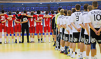 11 JUN 2010 - LONDON, GBR -  - Great Britain (red) and Estonia (white and black) stand for the National Anthems before their 2012 European Handball Championships Qualification Tournament match .(PHOTO (C) NIGEL FARROW)