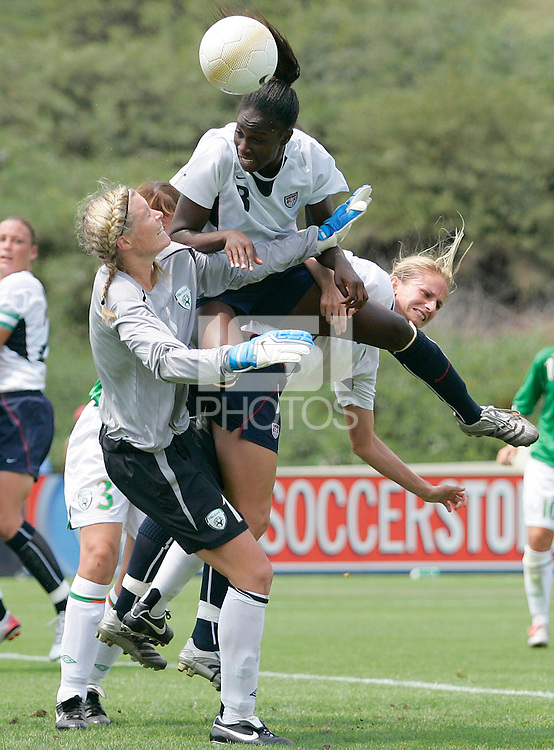 USA's Tina Frimpong heads the ball towards the goal over Ireland's goalie, Emma Byrne.during a 5-0 victory over Ireland in San Diego, California, Sunday, July 23, 2006.